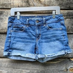 AEO Stretch MidRise Raw Hem Jean Shorts